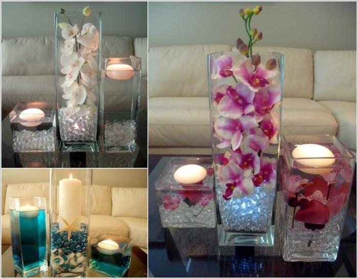 Wohnzimmer Deko mit Wasserkerzen, dekorativen Steinen, Muscheln und Blumen