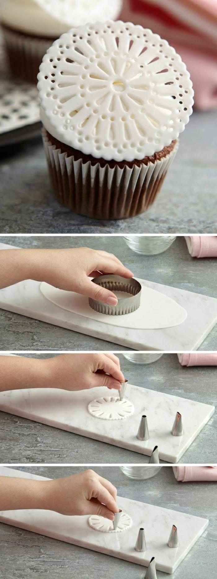 schoko-cupcake mit ronder dekoration aus weißem fondant verzieren