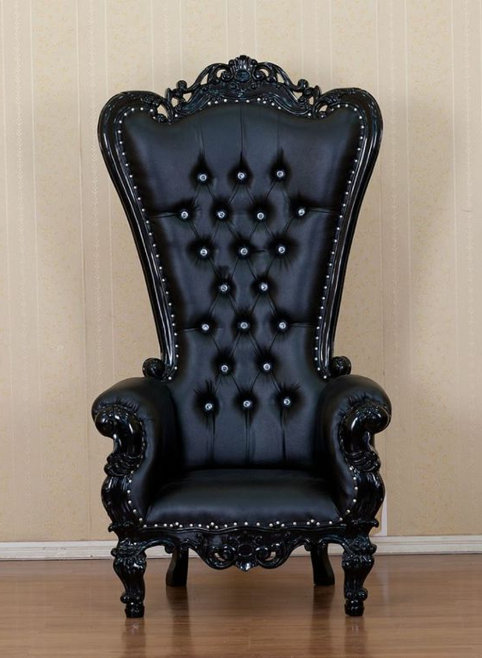 Sessel aus schwarz gefärbtem Leder mit großer Rückenlehne aus Holz, Metallkapsen