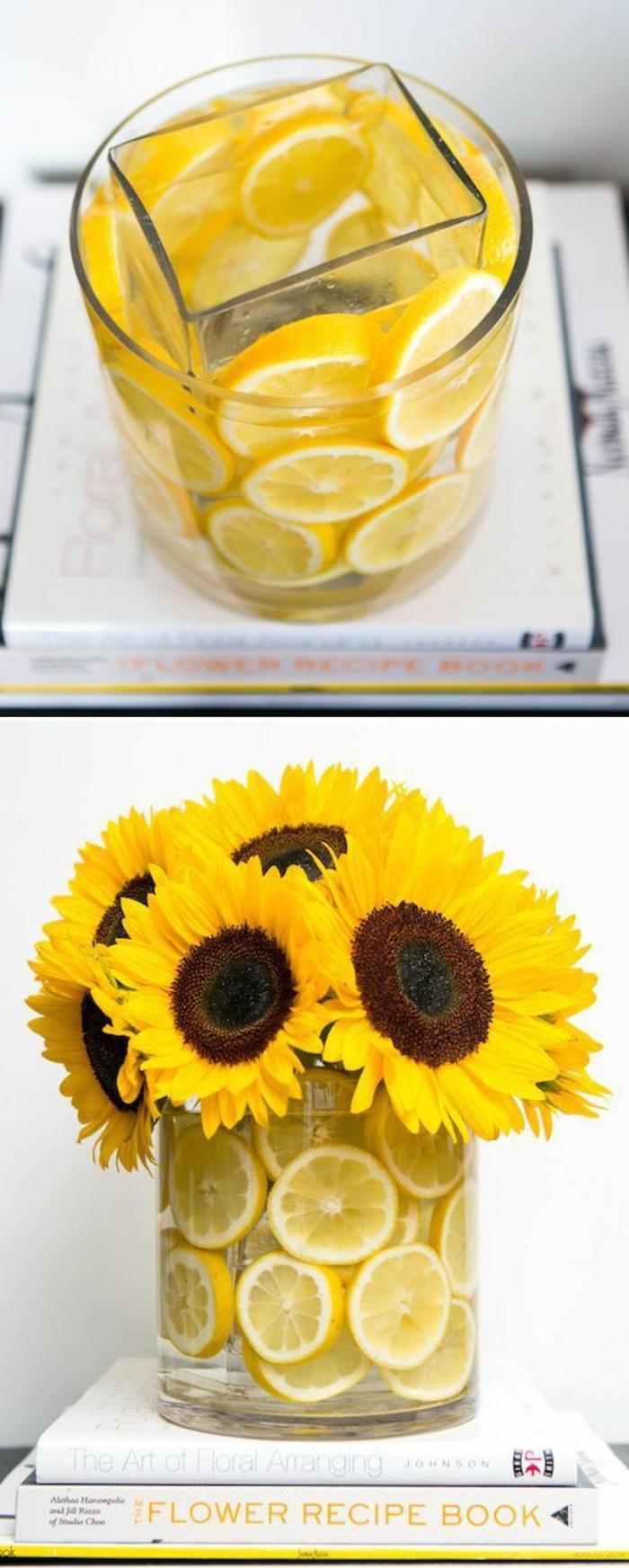 vase aus glas dekoriert mit zitronenschalen, gelbe blumen, sonnenblumen