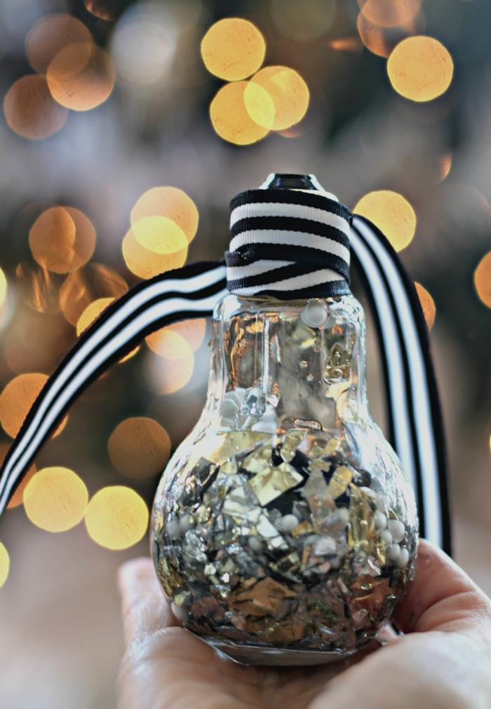 diy weihnahchtsdeko aus birne und silbernen papierstücken