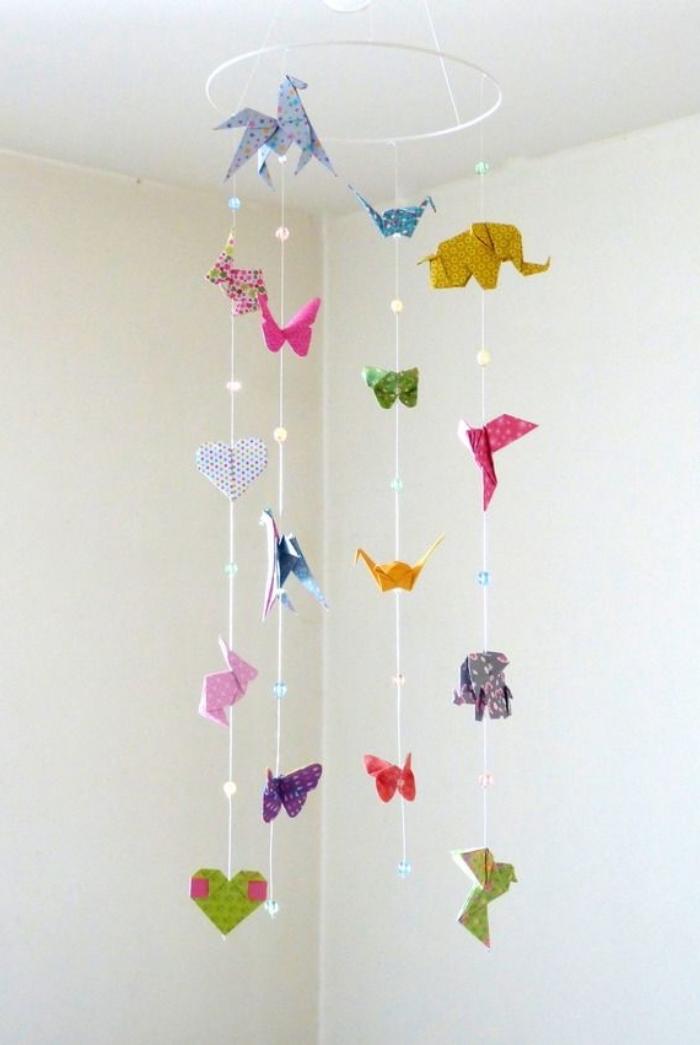 basteln mit papier anleitung kostenlos, origami tiere aus buntem bastelpapier, babyzimmer deko