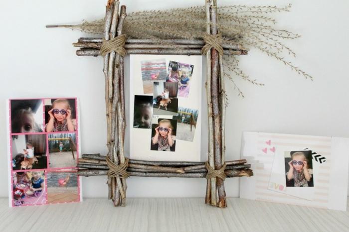 diy fotorahmen dekoriert mit kleinen ästen, familienfotos
