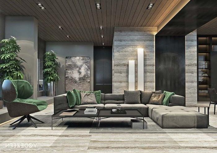 deko wohnzimmer modern, graues zimmer, mit grünen dekorationen, grüner sessel