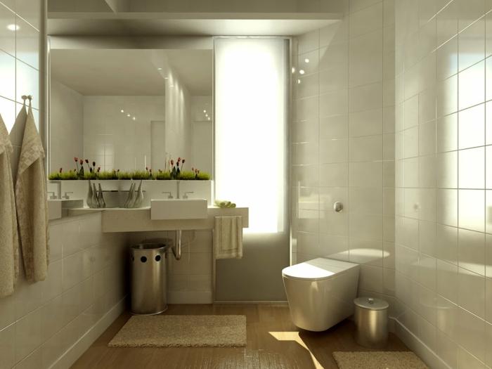 klassische weiße Badfliesen an den Wänden, Bodenfliesen wie Laminatboden, Frühlingsdeko am Spiegel