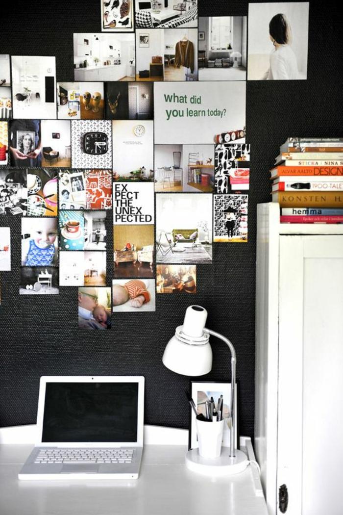 Bilder in unterschiedlichen Größen auf schwarzer Wand