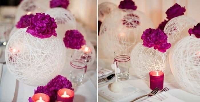 frühlingsdeko basteln. bälle aus faden mit lila blumen, tischdeko, kerzen