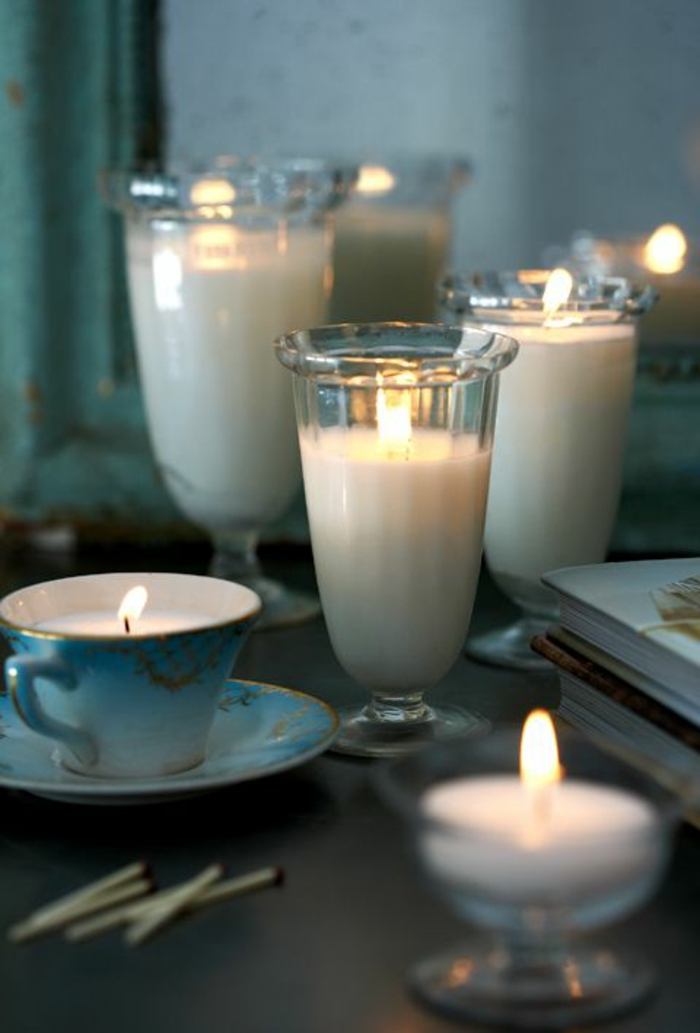 weiße kerze. teetasse, gläser, diy dekoration