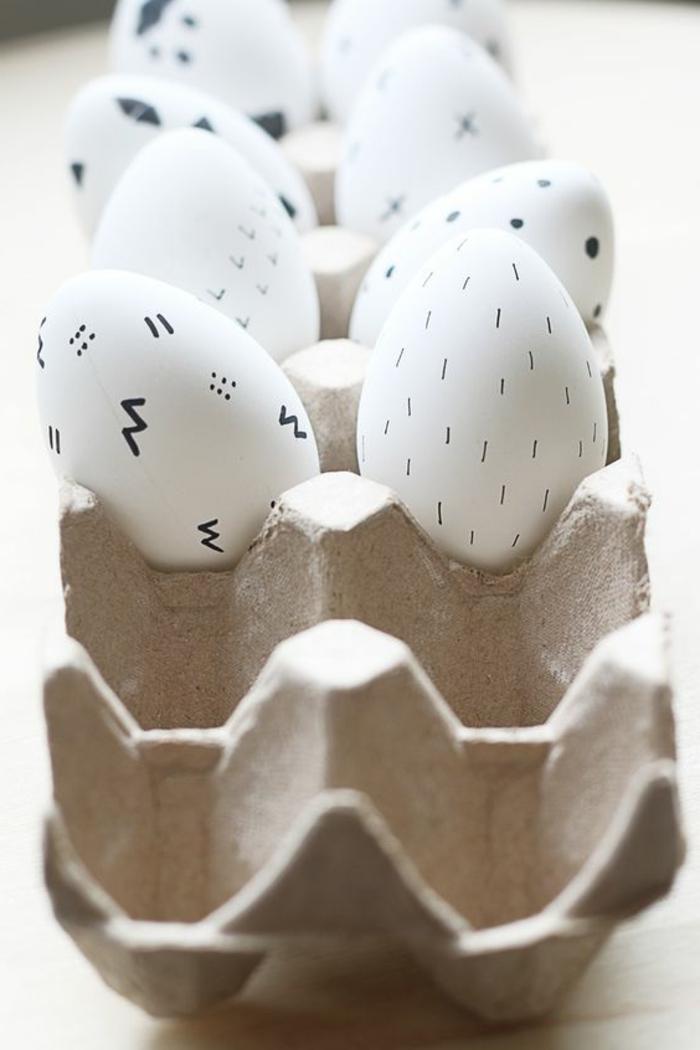 Weiße lustige Eierbilder mit Filzstift die Motive selbst kreieren - Wellen, Punkte