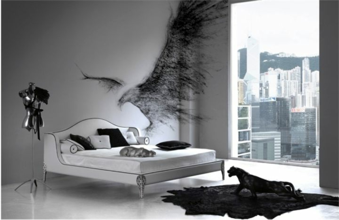 modernes Gothic-Schlafzimmer mit weißem Doppelbett, Wand-Graffiti, schwarzer Teppich, schwarze Puma