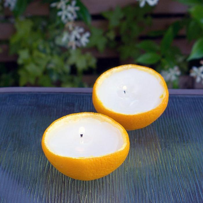 Kerzen in Orangenschalen aus Wachsreste, Insektenschutz Kerze, upcycling Ideen zum Selbermachen