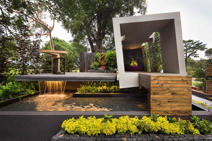 vertikaler Garten in modernistischem Stil - ein Würfel und eine Skulptur