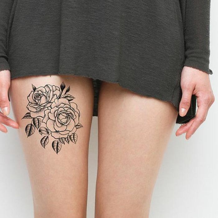 kleine tattoo ideen tattoos auf oberschenkel von einer frau rosen mit kleinen blättern kleid grün
