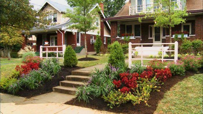 schöne Vorgarten mit symmetrische Gestaltung in Beeten - zwei Bäume