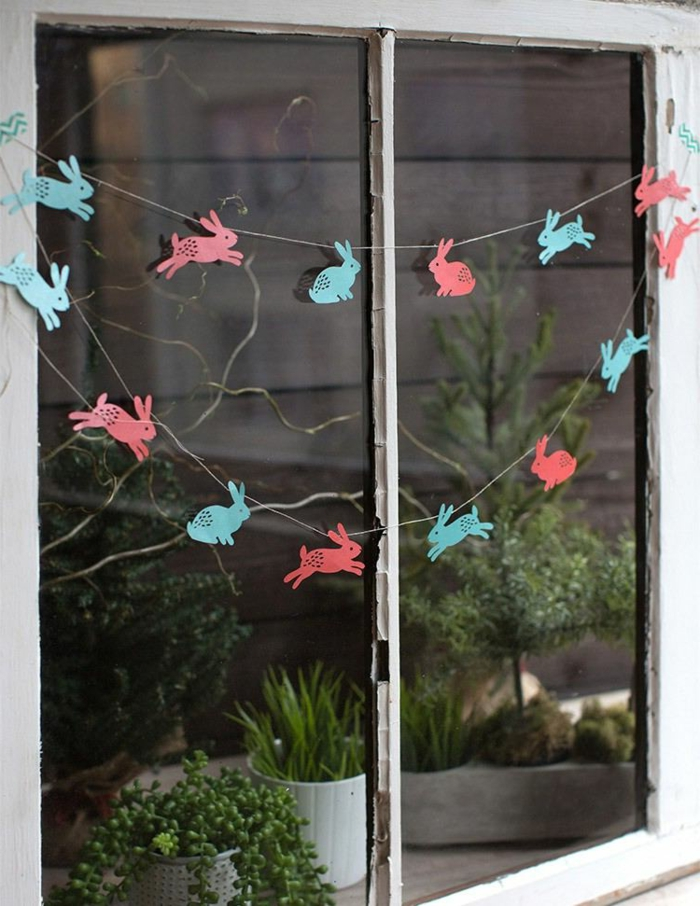 liebevolle Fensterdeko Ostern basteln Osterhasen aus Tonkarton