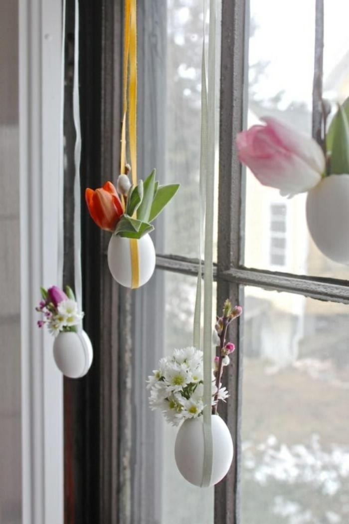 Vasen basteln für die Fensterdeko Ostern aus frischen Blüten