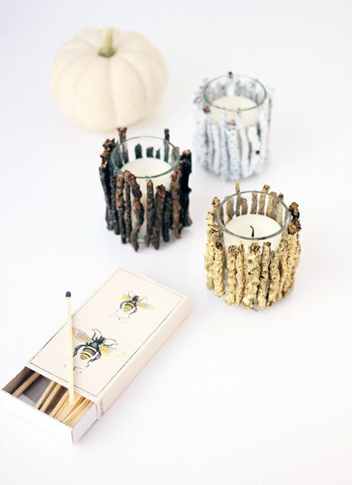 teelichthalter aus glas, streichholz, holzstückchen, weiße kerzen