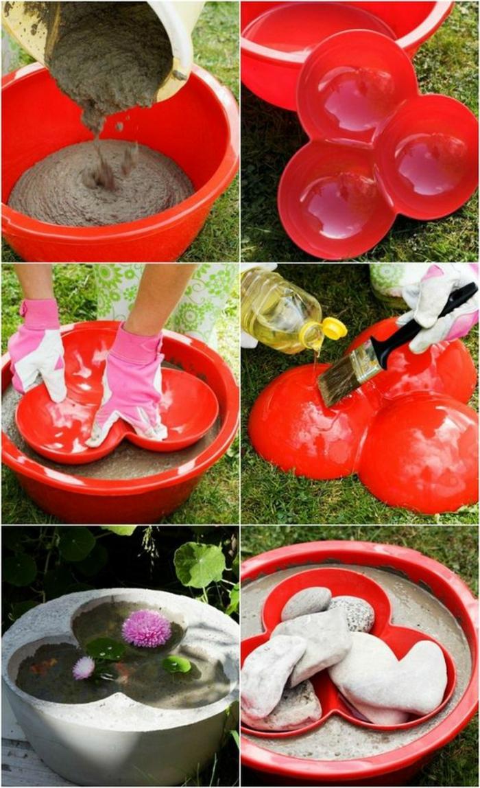 diy gartendeko aus zement - pinsel, steine, rote plastikform