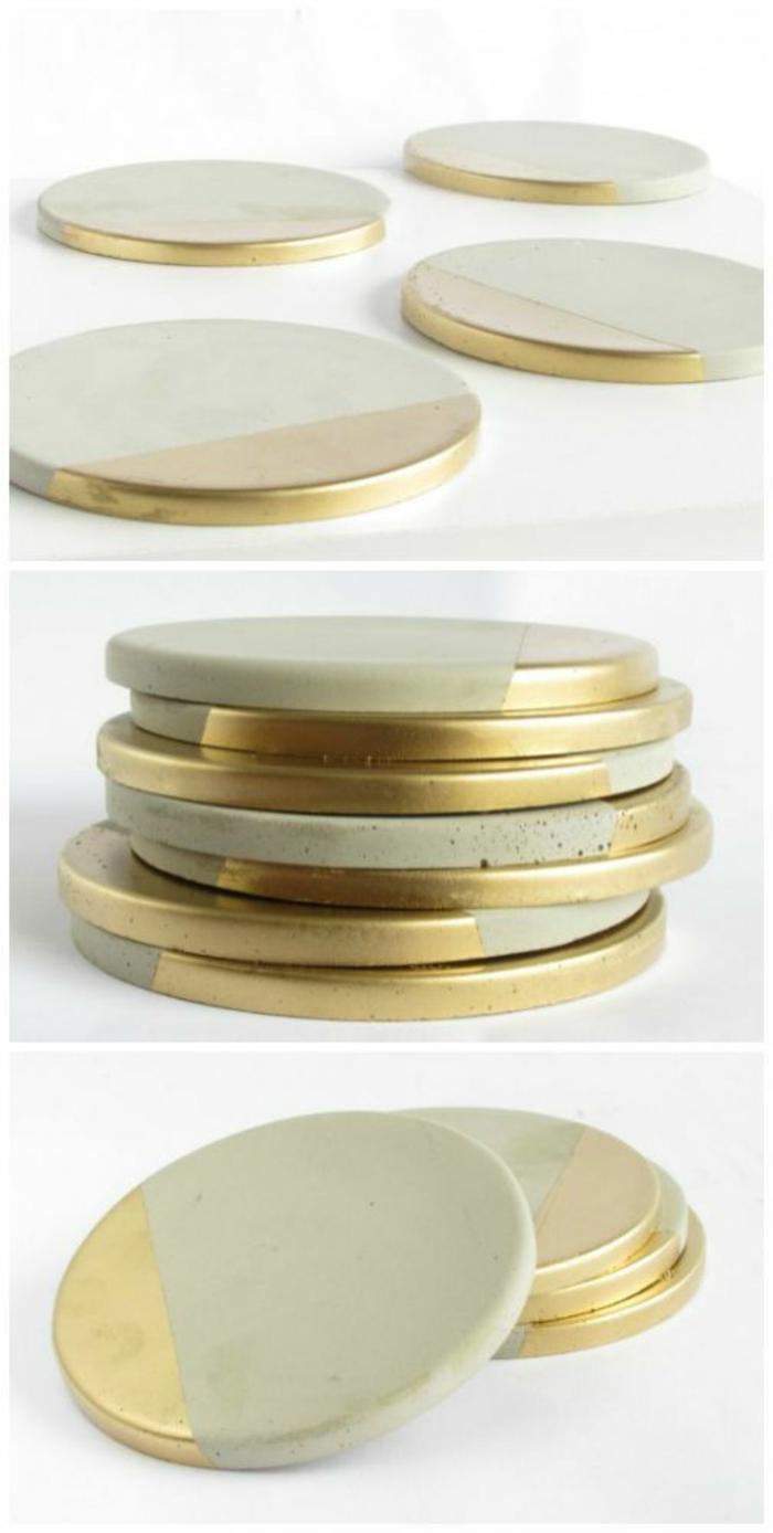 runde selbstgemachtete untersetzer aus zement dekoriert mit goldener farbe