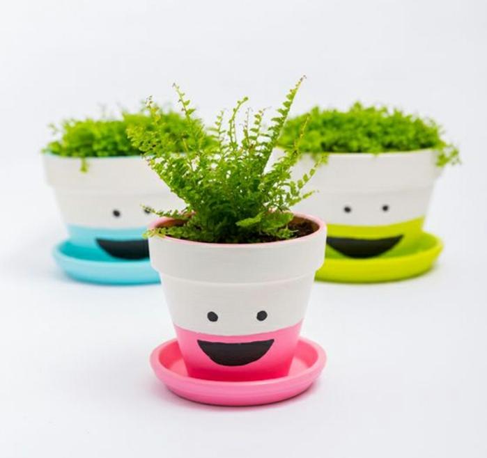 blumentopf übertöpfe selber machen schöne lächelnde töpfe topfdesign ideen rosa grün und blau gestaltungsidee