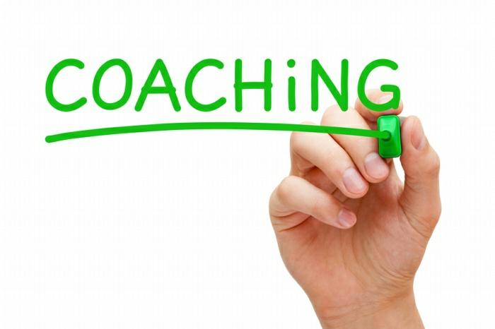 Coaching mit einem grünen Filzstift geschrieben