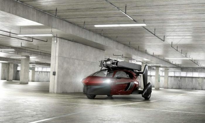 pal-v - hier ist eine garage mit einem roten auto, das fliegen kann