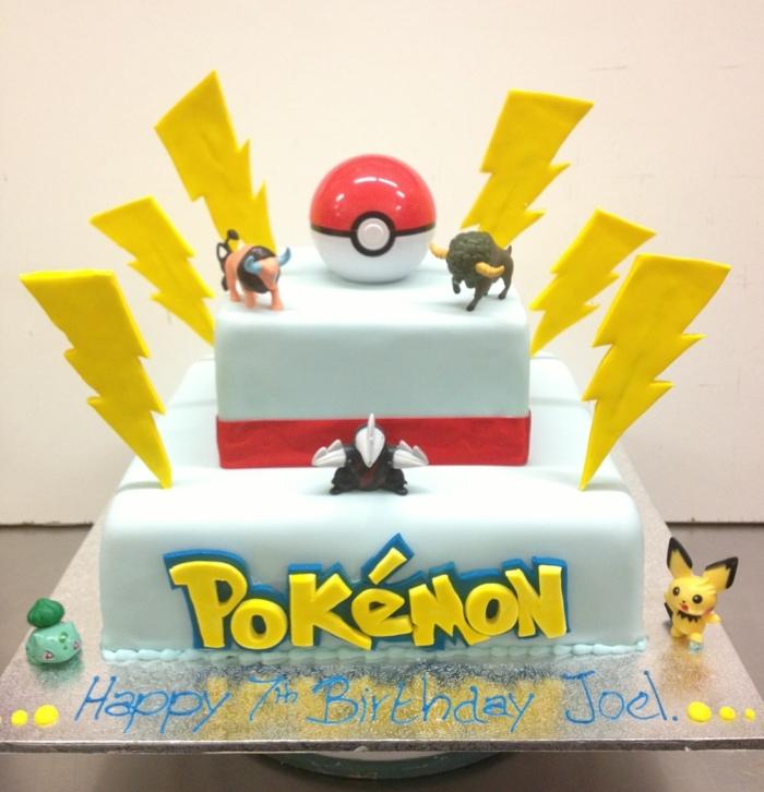 bulle, pikachu, kleine pokemon wesen, ein roter pokeball und gelbe blitze - tolle idee für eine zweistöckige torte