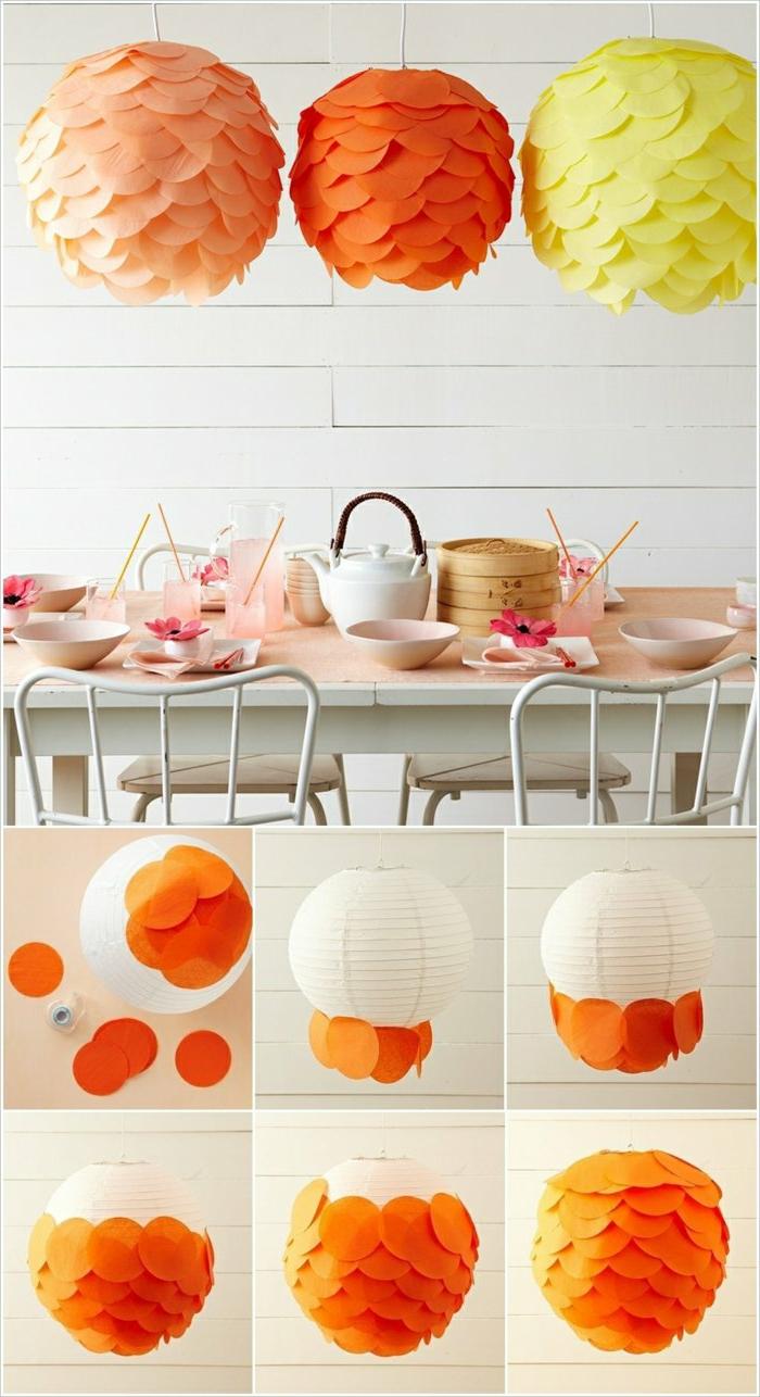 runde Lampenschirme in hellgelb, hellorange und hellping, gebastelt aus Bastelpapier
