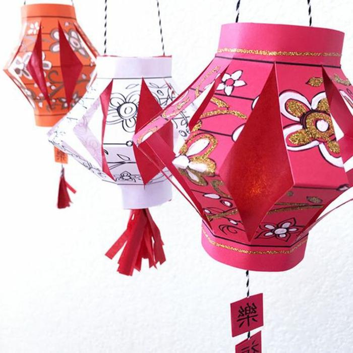 diy papierlaternen in verschiedenen farben dekoriert mit blumen