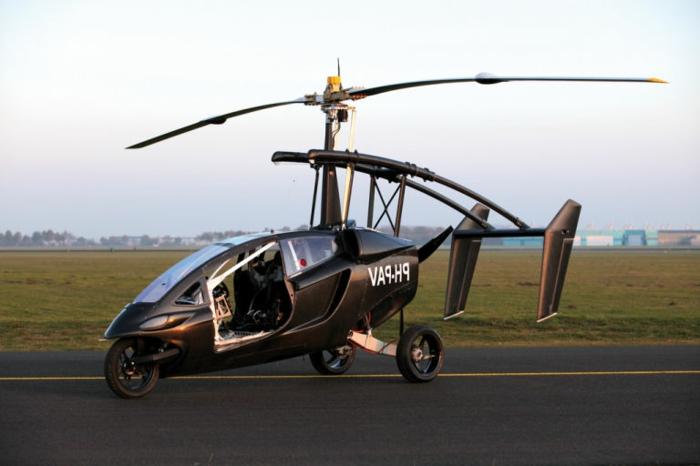 hier ist pal-v - das ist ein schwarzes fliegendes auto, und eine startbahn
