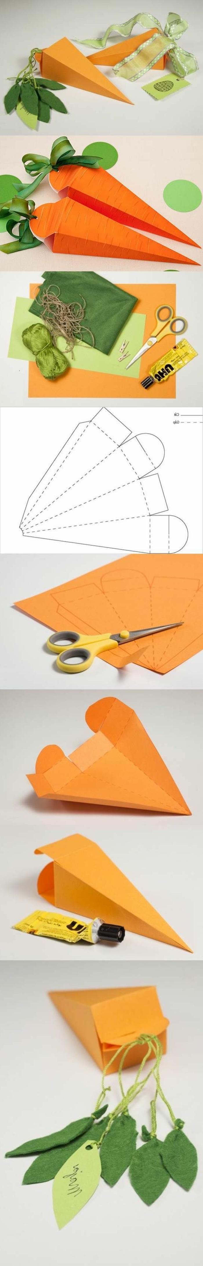 karotten aus orangen papier mit grünen blättern, schere
