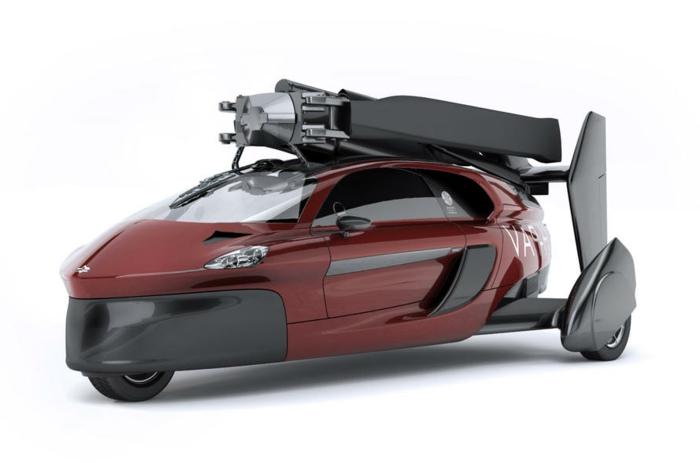 das ist ein schönes, rotes, fliegendes auto mit schwarzen propellern - pal-v