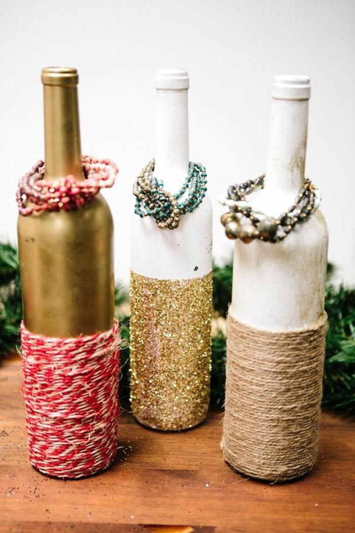 weinflaschen dekoriert mit farbe, glitzer und faden, armreife