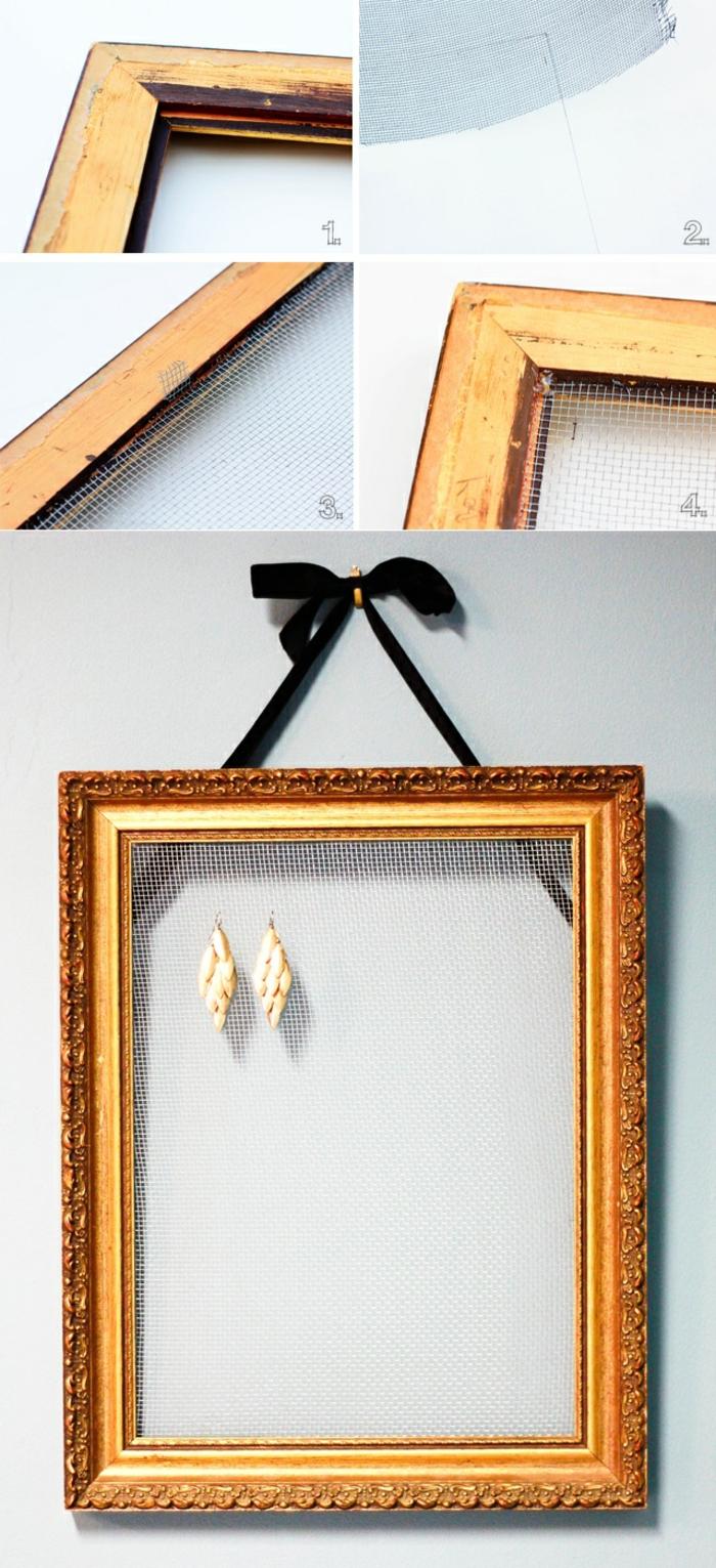 ohrringhalter, schwarze schleife, goldener bilderrahmen, maschendraht