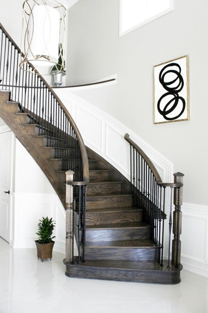 Bilder für Treppenhaus - abstrakte runde Formen in schwarzer Farbe, Vasen darauf und darunter