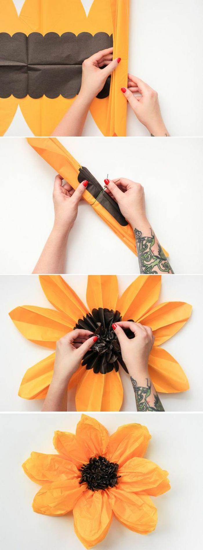 große orange blume aus papier selber machen, tattoo, armtattoo