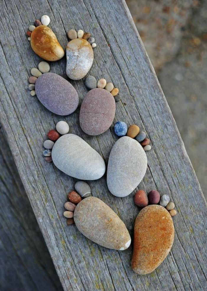 Fußmatte basteln steine verschiedener größe auf holzbrett legen