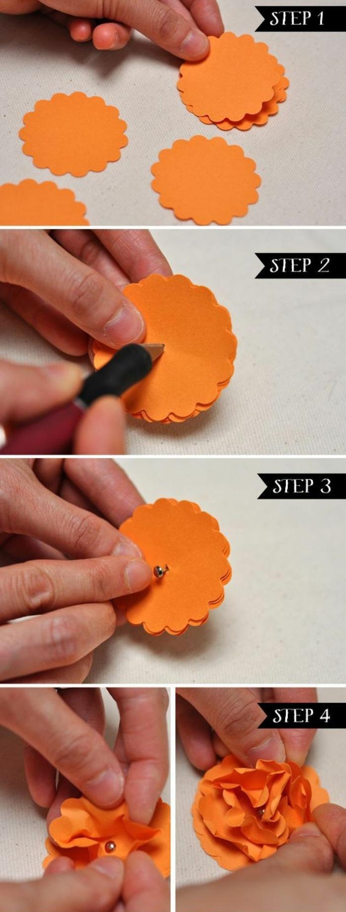 kleine blume aus orangem papier falten, cutter, diy papierblume