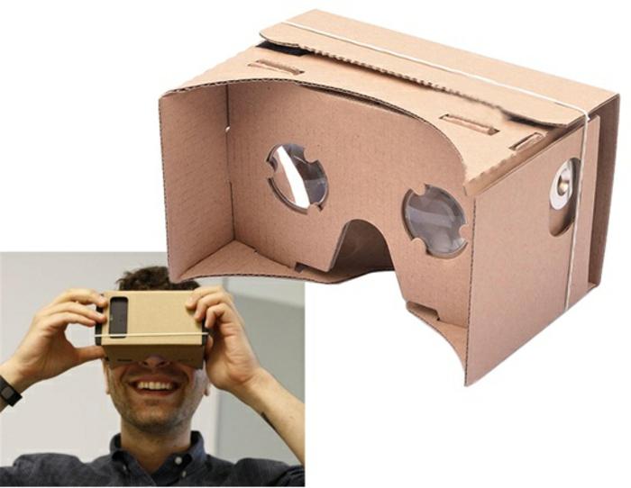hier ist noch ein mann, virtuelle realität brille aus pappe, ein schwarzes smartphone und ein gummiband