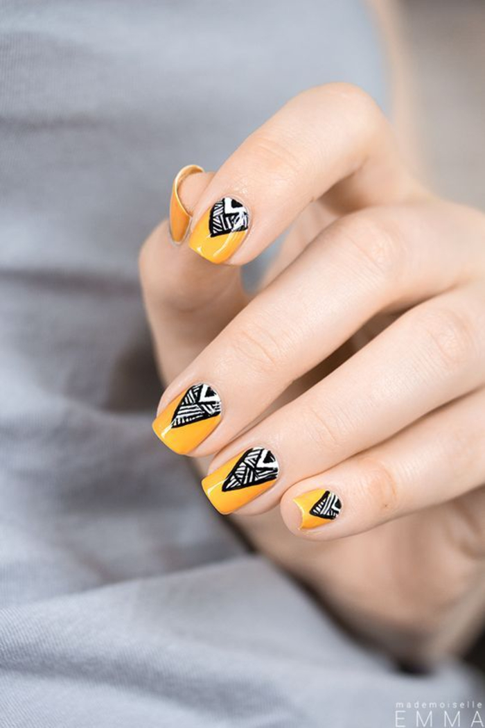 gelber Nagellack, schwarze Dekoration, Sommerideen für schöne Fingernägel
