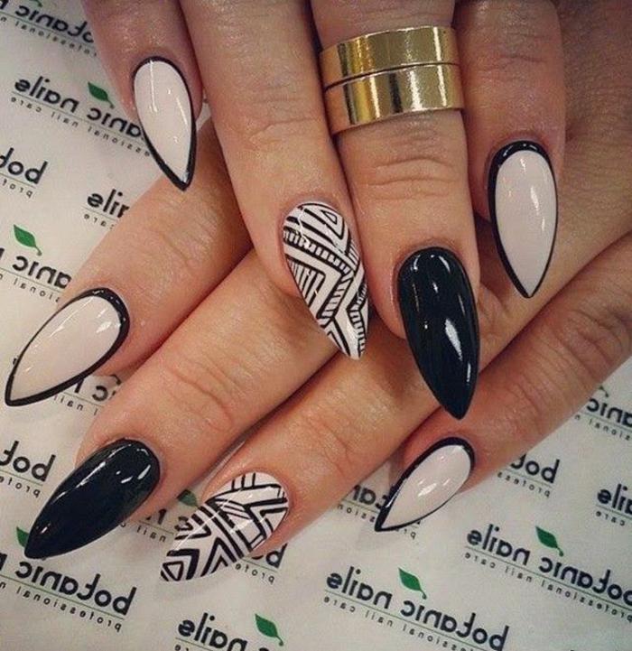 nägel bilder zum erstaunen lange spitzige nägel mit schwarzen dekorationen beige farbe nagellack ideen