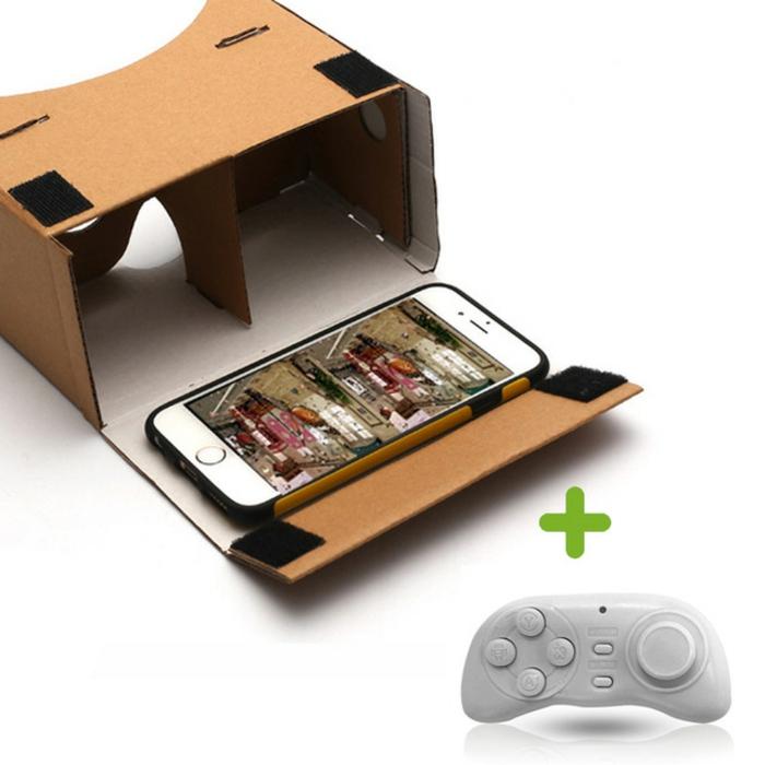 ausgefallene selbst gemachte vr brille aus pappe, ein Joystick und ein kleines weißes smartphone