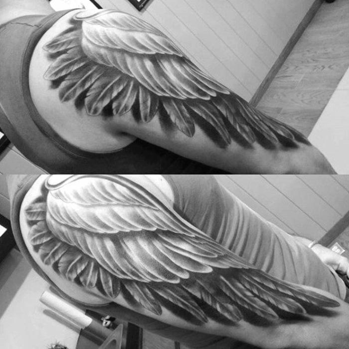 hier ist noch eine idee für einen tollen engel tattoo für die männer - hier sind hände mit großen schwarzen engelsflügel tattoos