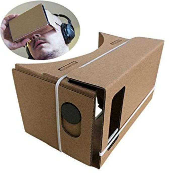 hier ist eine idee für selbst gemachte vr brille aus pappe mit einem kleinen weißen gummiband - ein mann mit vr brille