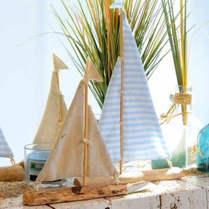 Segelschiffe verschiedener Größen basteln mit Treibholz Stoffreste