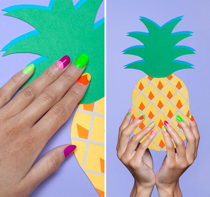 Sommermaniküre in grellen Farben, jeder Nagel in verschiedener Farbe, Ananas als Hintergrund