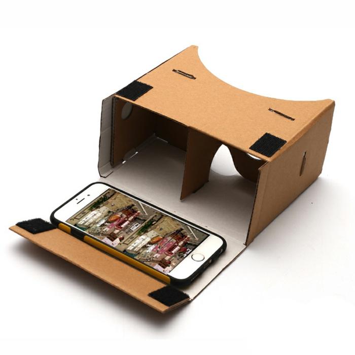 hier zeigen wir ihnen vr brille aus pappe und außerdem ein kleines weißes smartphone - eine idee für selbt gebaute vr brille