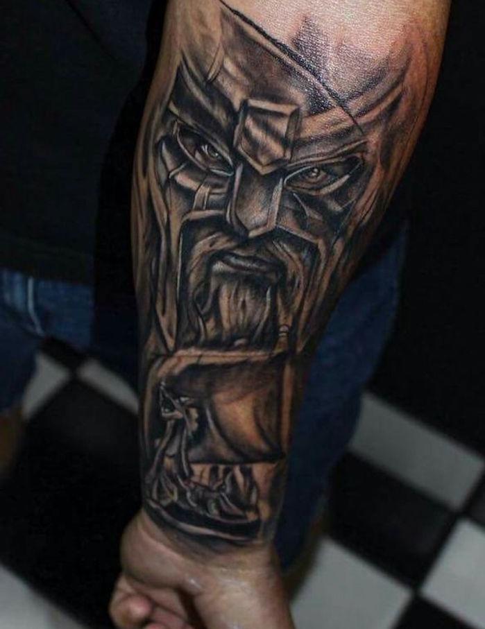 viking tattoos, wikinger mit langem bart und helm, armtattoo