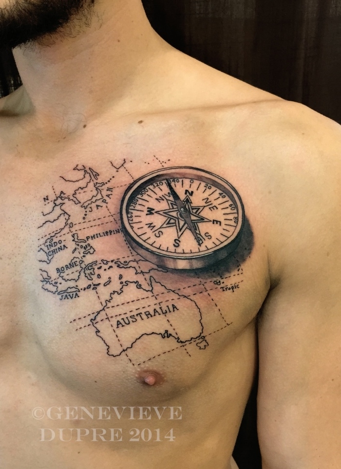 werfen sie einen blick auf diese idee für einen compass tattoo für männer - hier sund ein großer schwarzer kompass und die weltkarte