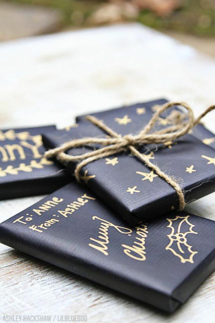 schwarze Verpackungen mit Schnur gebunden goldene Aufschriften - Geschenke schön verpacken